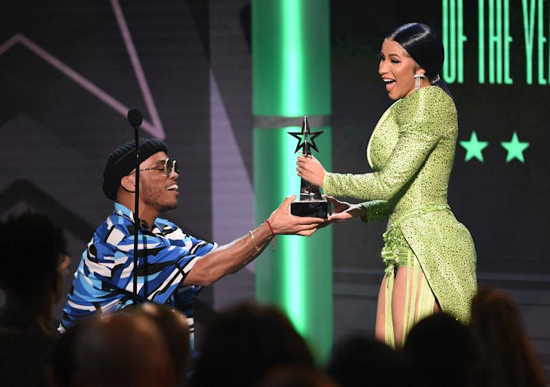 Anderson .Paak, left, presents the album of the year award to Cardi B at the BET Awards on Sunday, June 23, 2019, at the Microsoft Theater in Los Angeles. (Photo by Chris Pizzello/Invision/AP) ORG XMIT: CADC192