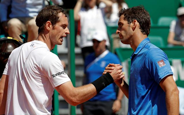 <span>Murray (L) and Albert Ramos-Vinolas shake hands at the end of the match</span>