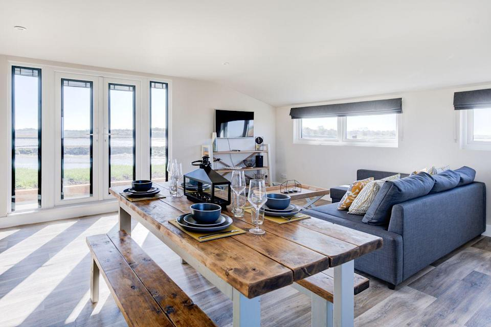 """<p>If we could immediately pack our bags and move into this weather-boarded cabin that looks over the marshes of the Ray Channel then we would in a heartbeat. </p><p>Away from the hustle and bustle of Essex lies this adorable coastal spot with views overlooking boats in the estuary and the causeway leading to Mersea Island. </p><p>With a sofa on the decking where you can read a book, kayaks for exploring the wetland and local attractions including jam tasting at the Tiptree Tearooms, you won't exactly be bored here. </p><p><strong>Cabin for 2 adults (and 2 children) from £100 per night</strong></p><p><a class=""""link rapid-noclick-resp"""" href=""""http://www.canopyandstars.co.uk/samphire"""" rel=""""nofollow noopener"""" target=""""_blank"""" data-ylk=""""slk:BOOK ONLINE"""">BOOK ONLINE</a></p>"""