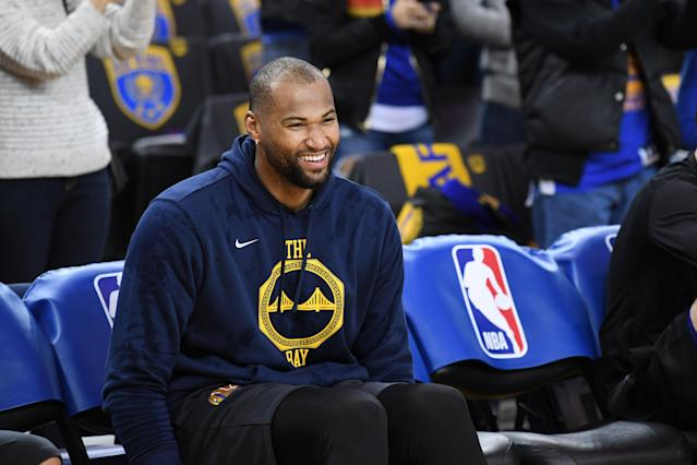 DeMarcus Cousins laughs on the bench before Wednesday's win over the New Orleans Pelicans. (Getty Images)