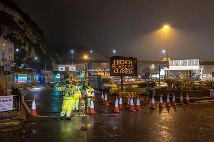 Police stand by a closed port at Dover, England, Dec. 21, 2020. (Andrew Testa/The New York Times)