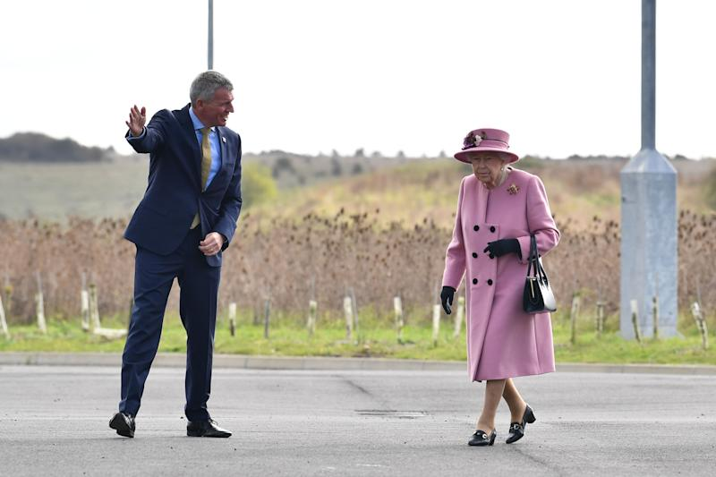 Britain's Queen Elizabeth II (R) is greeted by Dstl Chief Executive Gary Aitkenhead (L) as she arrives at the Energetics Analysis Centre as they visit the Defence Science and Technology Laboratory (Dstl) at Porton Down science park near Salisbury, southern England, on October 15, 2020. - The Queen and the Duke of Cambridge visited the Defence Science and Technology Laboratory (Dstl) where they were to view displays of weaponry and tactics used in counter intelligence, a demonstration of a Forensic Explosives Investigation and meet staff who were involved in the Salisbury Novichok incident. Her Majesty and His Royal Highness also formally opened the new Energetics Analysis Centre. (Photo by Ben STANSALL / POOL / AFP) (Photo by BEN STANSALL/POOL/AFP via Getty Images)