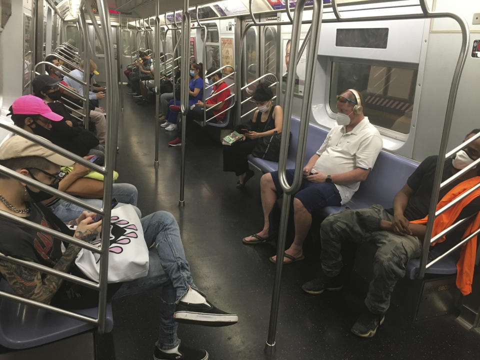 Photo by: STRF/STAR MAX/IPx 2020 6/22/20 Subway riders continue to wear masks during the phase 2 reopening amidst the Coronavirus Pandemic in New York City.