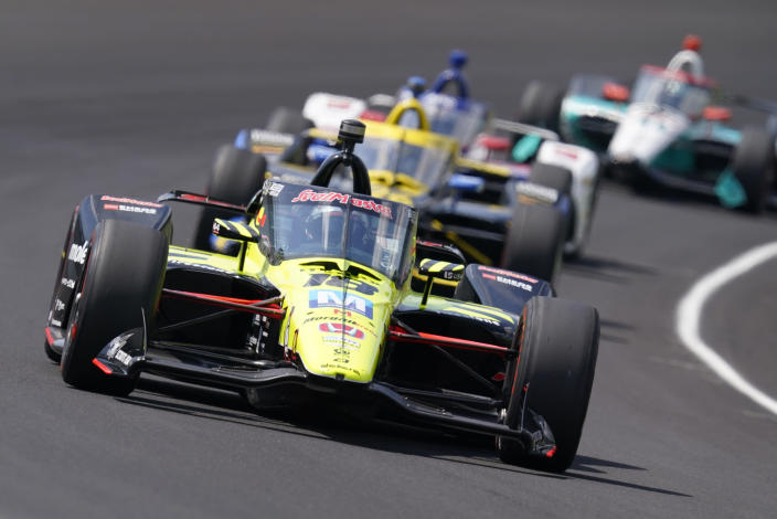 FILE - Santino Ferrucci drives into turn one during the Indianapolis 500 auto race at Indianapolis Motor Speedway in Indianapolis, in this Sunday, Aug. 23, 2020, file photo. Ferrucci has landed a ride for the Indianapolis 500 with Rahal Letterman Lanigan Racing. The team finished first and third in last year's race with Takuma Sato and Graham Rahal, while Ferrucci was fourth. Now RLL will return to Indy with a driver lineup that claimed three of the top four spots a year ago.(AP Photo/Darron Cummings, File)
