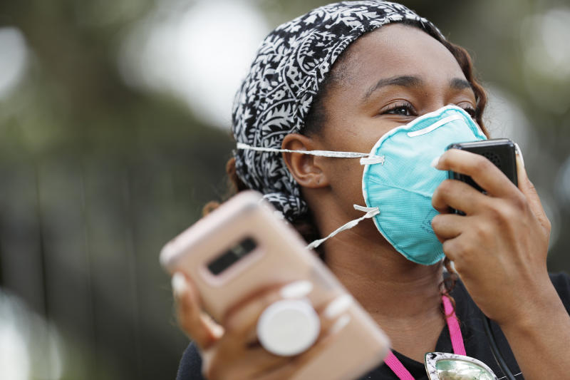 TAMPA, FL - JULY 02: Makyla Burks, a University of South Florida student wears a face mask while protesting in front of the Lifsey residence where the University of South Florida President Steven Currall lives on campus on July 2, 2020 in Tampa, Florida. Tampa Bay Students for Democratic Society protest at the University of South Florida demanding an increase in Black student enrollment, employ more Black faculty and staff, more financial aid, and make direct connections with the surrounding community. (Photo by Octavio Jones/Getty Images)