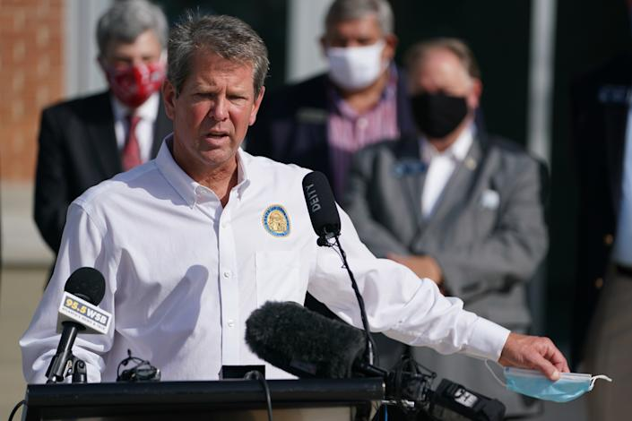Brian Kemp, governor of Georgia, holds a protective mask while speaking during a 'Wear A Mask' tour stop in Dalton, Georgia, U.S., on Thursday, July 2, 2020. (Elijah Nouvelage/Bloomberg via Getty Images)