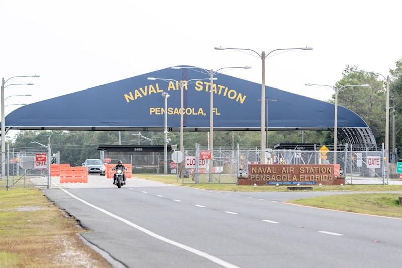 Traffic makes its way through the west gate at NAS Pensacola on Monday, December 9, 2019.