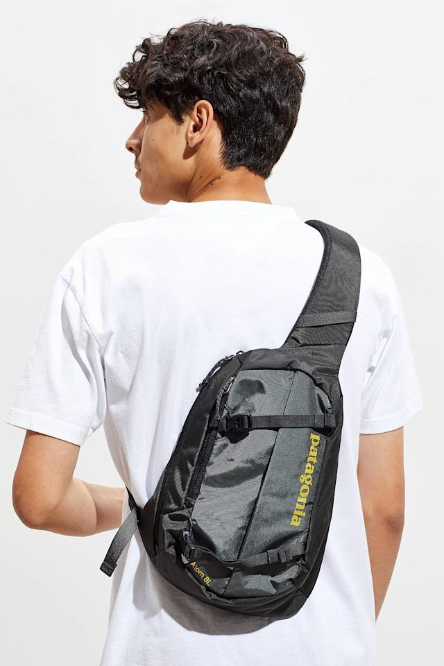"<p>He'll never tire of rocking this <a href=""https://www.popsugar.com/buy/Patagonia-Atom-8L-Sling-Bag-499433?p_name=Patagonia%20Atom%208L%20Sling%20Bag&retailer=urbanoutfitters.com&pid=499433&price=59&evar1=savvy%3Aus&evar9=45684857&evar98=https%3A%2F%2Fwww.popsugar.com%2Fphoto-gallery%2F45684857%2Fimage%2F46825659%2FPatagonia-Atom-8L-Sling-Bag&list1=shopping%2Cgifts%2Cgift%20guide%2Cgifts%20for%20men%2Cbest%20of%202019&prop13=api&pdata=1"" rel=""nofollow"" data-shoppable-link=""1"" target=""_blank"" class=""ga-track"" data-ga-category=""Related"" data-ga-label=""https://www.urbanoutfitters.com/shop/patagonia-atom-8l-sling-bag?category=SEARCHRESULTS&amp;color=003"" data-ga-action=""In-Line Links"">Patagonia Atom 8L Sling Bag</a> ($59).</p>"