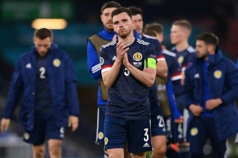 Dejected Scotland players led by Andy Robertson pay tribute to their fans at Hampden Park after exiting Euro 2020