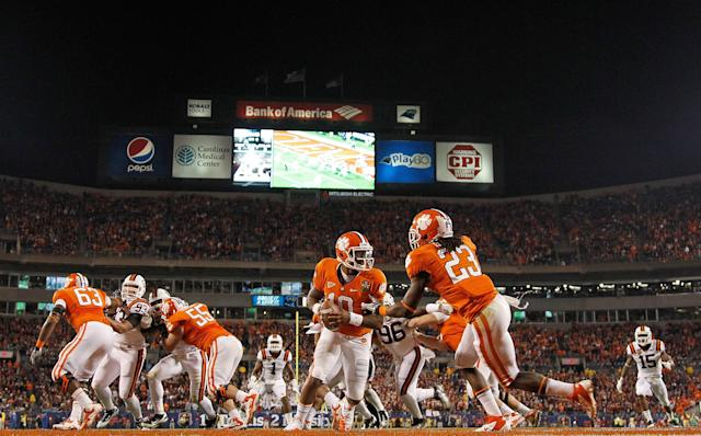 CHARLOTTE, NC - DECEMBER 03: Tajh Boyd #10 of the Clemson Tigers hands off to Andre Ellington #23 during the ACC Championship game against the Virginia Tech Hokies at Bank of America Stadium on December 3, 2011 in Charlotte, North Carolina. (Photo by Mike Ehrmann/Getty Images)