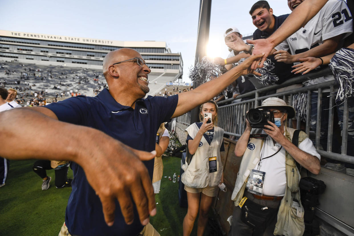 Penn State head coach James Franklin celebrates with fans following a 44-13 victory over Ball State in an NCAA college football game in State College, Pa., on Saturday, Sept. 11, 2021. (AP Photo/Barry Reeger)