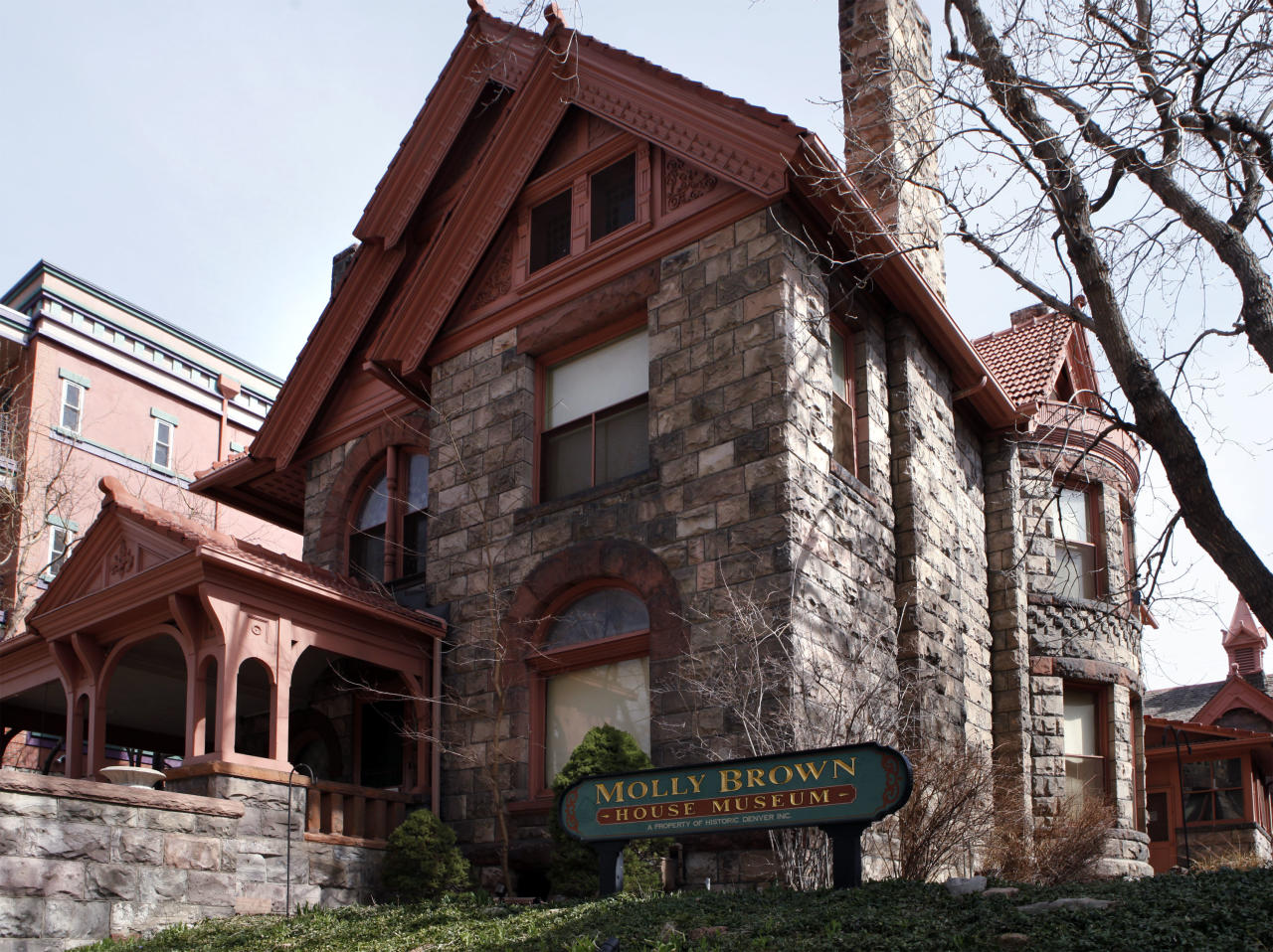 "This March 12, 2012 photo shows the front of the Molly Brown House Museum in Denver. A few blocks from Colorado's state Capitol _ over 1700 miles from the Atlantic Ocean and a mile above sea level _ is a museum dedicated to a woman eclipsed by legend following the sinking of the Titantic. The ""unsinkable Molly Brown"" moved into this stone Victorian home after she and her husband struck it rich at a gold mine in Colorado's mountains, nearly 20 years before she boarded the Titanic because it was the first boat she could get back home on to visit her ailing grandson. (AP Photo/Ed Andrieski)"