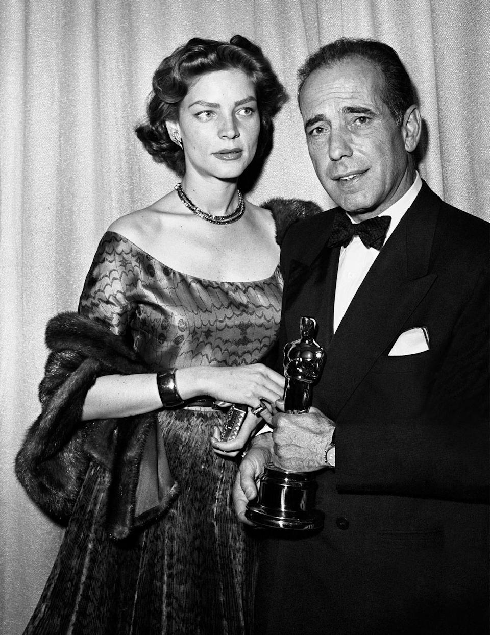 "<p>Humphrey Bogart and wife <a href=""https://www.goodhousekeeping.com/home/a27273/lauren-bacall-antique-home/"" rel=""nofollow noopener"" target=""_blank"" data-ylk=""slk:Lauren Bacall"" class=""link rapid-noclick-resp"">Lauren Bacall</a> arrived in style to the ceremony at Hollywood's Pantages Theater, where Bogart won Best Actor for <em><a href=""https://www.amazon.com/dp/B003F3ITNE?ref=sr_1_1_acs_kn_imdb_pa_dp&qid=1547577874&sr=1-1-acs&autoplay=0&tag=syn-yahoo-20&ascsubtag=%5Bartid%7C10055.g.5132%5Bsrc%7Cyahoo-us"" rel=""nofollow noopener"" target=""_blank"" data-ylk=""slk:The African Queen"" class=""link rapid-noclick-resp"">The African Queen</a></em>.</p>"