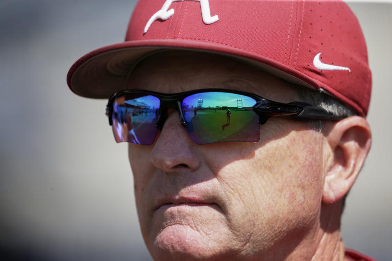TD Ameritrade Park, home of the College World Series, is reflected in the sunglasses of Arkansas NCAA college baseball coach Dave Van Horn during team practice in Omaha, Neb., Friday, June 14, 2019. Arkansas opens College World Series play Saturday night against Florida State, which will be trying to win retiring coach and NCAA all-time wins leader Mike Martin's first national championship in his 17 visits to Omaha. (AP Photo/Nati Harnik)