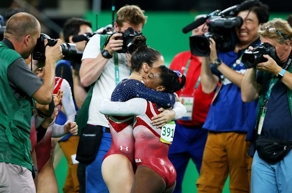 <p>Simone Biles (R) and Alexandra Raisman (L) of the United States celebrate winning the gold medal during the Artistic Gymnastics Women's Team Final on Day 4 of the Rio 2016 Olympic Games at the Rio Olympic Arena on August 9, 2016 in Rio de Janeiro, Brazil. (Photo by Alex Livesey/Getty Images) </p>