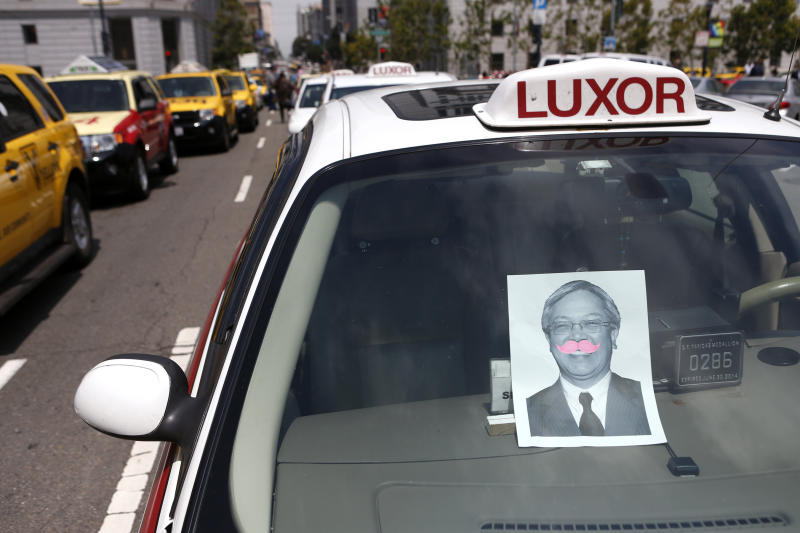 A photo of San Francisco Mayor Ed Lee adorns a pink mustache of Lyft, one of the ride sharing programs taxi drivers say is operating illegally, during a taxi strike in San Francisco, California, July 30, 2013. REUTERS/Beck Diefenbach (UNITED STATES - Tags: POLITICS CIVIL UNREST TRANSPORT BUSINESS)