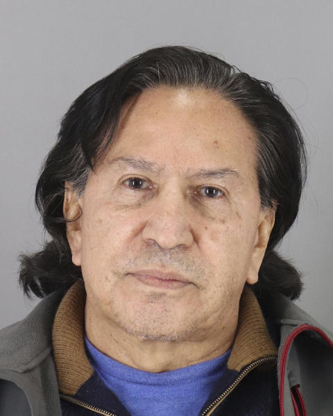 """FILE - This booking photo released Monday, March 18, 2019, by the San Mateo County Sheriff's Office shows former Peruvian President Alejandro Toledo. A U.S. judge in San Francisco says, Toledo can be released on bail while he fights extradition to his native country to face corruption charges. U.S. District Judge Vince Chhabria ordered Toledo released from Santa Rita Jail but said the former president can't leave before Oct. 22, 2019, to give federal prosecutors time to file an appeal or find a different """"detention arrangement."""" (San Mateo County Sheriff's Office via AP, File)"""