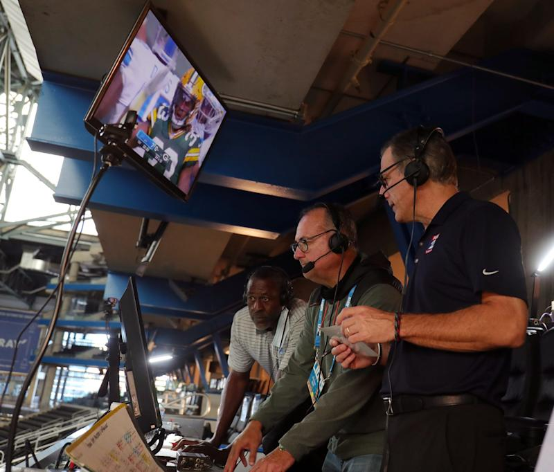 The WJR-AM broadcast team of Dan Miller (right), spotter Joe Abramson (center) and Lomas Brown broadcast action of the Detroit Lions game against the Green Bay Packers from Ford Field on Sunday, Sept. 20, 2020.