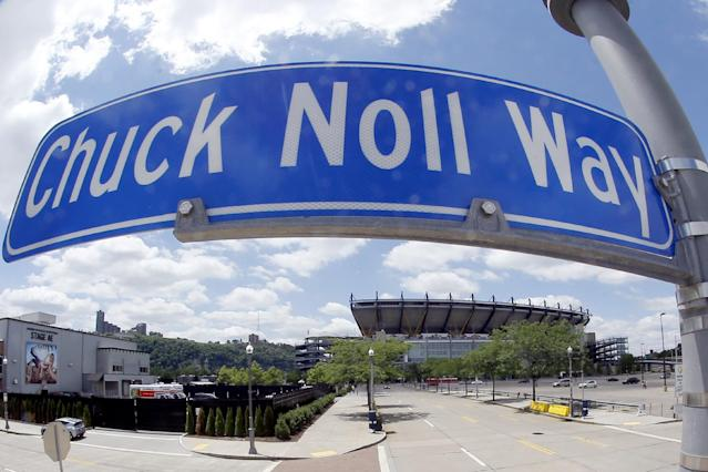 In this photo made with a fisheye lens, Heinz Field, where the Pittsburgh Steelers now play their NFL football games, is visible on Saturday, June 14, 2014, under the sign marking the street named Chuck Noll Way where Three Rivers Stadium stood when Noll coached the Steelers for 23 seasons in Pittsburgh. Noll, the Hall of Fame coach who won a record four Super Bowl titles with the Pittsburgh Steelers, died Friday, June 13, at his home. He was 82. The Allegheny County Medical Examiner said Noll died of natural causes. (AP Photo/Keith Srakocic)