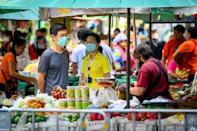 Thailand allowed businesses such as restaurants, hair salons and outdoor markets to reopen so long as social distancing was maintained (AFP Photo/Mladen ANTONOV)