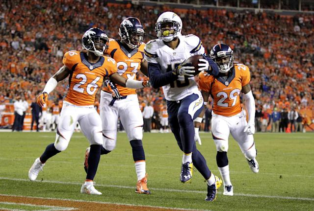 San Diego Chargers wide receiver Keenan Allen (13) scores a touchdown as Denver Broncos' Rahim Moore (26), Quanterus Smith (93) and Bradley Roby (29) defend during the first half of an NFL football game, Thursday, Oct. 23, 2014, in Denver. (AP Photo/Joe Mahoney)