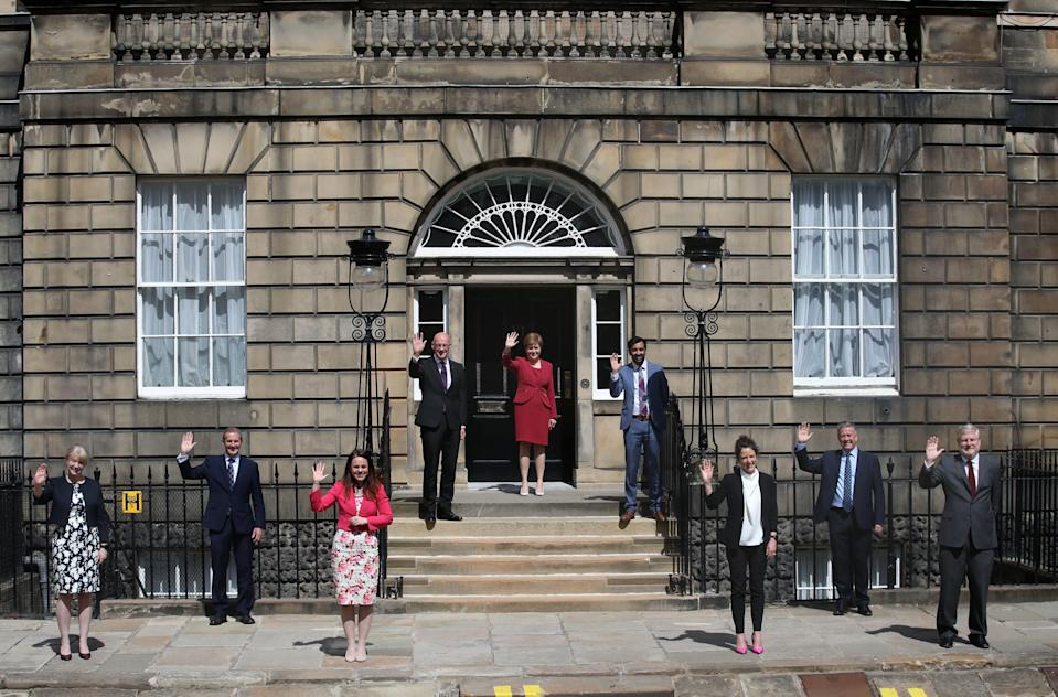 First Minister Nicola Sturgeon on the steps of Bute House in Edinburgh alongside her newly formed Cabinet (Andrew Milligan/PA)