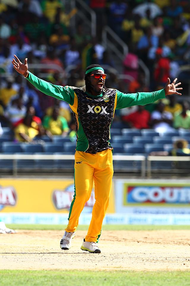 KINGSTON, JAMAICA - AUGUST 15: Chris Gayle appeals during the Sixteenth Match of the Cricket Caribbean Premier League between Jamaica Tallawahs v Guyana Amazon Warriors at Sabina Park on August 15, 2013 in Kingston, Jamaica. (Photo by Ashley Allen/Getty Images Latin America for CPL)