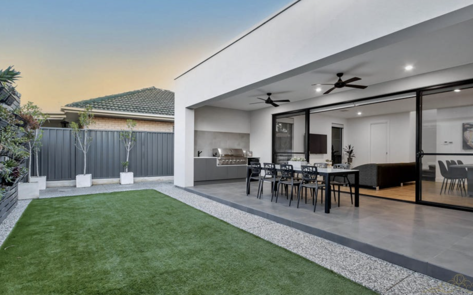 Backyard with alfresco dining at home located in 13 Warren Avenue