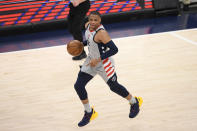 Washington Wizards guard Russell Westbrook (4) dribbles the ball during the first half of Game 3 in a first-round NBA basketball playoff series against the Philadelphia 76ers, Saturday, May 29, 2021, in Washington. (AP Photo/Nick Wass)