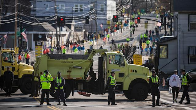 HOPKINGTON, MA - APRIL 21: Law enforcement officials, media, runners, administrators and volunteers mill about prior to the start of the Boston Marathon on April 21, 2014 in Hopkington, Massachusetts. Today marks the 118th Boston Marathon; security presence has been increased this year, due to two bombs that were detonated at the finish line last year, killing three people and injuring more than 260 others. (Photo by Andrew Burton/Getty Images)