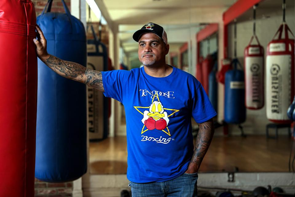 Ricky Funez, owner of the Ten Goose Boxing Gym in Van Nuys, said he was falsely charged with a criminal misdemeanor. His gym has been closed since March, following city orders, he said.
