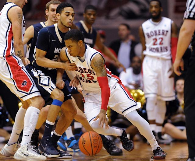 Robert Morris' Karvel Anderson (15) is fouled by Mount St. Mary's' Julian Norfleet during the first half of the Northeastern Conference championship NCAA college basketball game on Tuesday, March 11, 2014, in Coraopolis, Pa. (AP Photo/Don Wright)