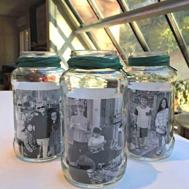 """<p>Whether or not you use a Mason jar or an empty spaghetti sauce jar like blogger Sharon Rowley did, placing family photos inside makes them a touching focal point for your holiday table.</p><p><strong>Get the tutorial at <a href=""""https://www.momof6.com/crafts/mason-jar-photo-centerpieces/"""" rel=""""nofollow noopener"""" target=""""_blank"""" data-ylk=""""slk:Mom of 6"""" class=""""link rapid-noclick-resp"""">Mom of 6</a>.</strong></p><p><a class=""""link rapid-noclick-resp"""" href=""""https://www.amazon.com/KGS-Satin-Ribbon-Yards-Forest/dp/B078WNMN77/ref=asc_df_B078WNMN77/?tag=syn-yahoo-20&ascsubtag=%5Bartid%7C10050.g.2132%5Bsrc%7Cyahoo-us"""" rel=""""nofollow noopener"""" target=""""_blank"""" data-ylk=""""slk:SHOP GREEN RIBBON"""">SHOP GREEN RIBBON</a><br></p>"""