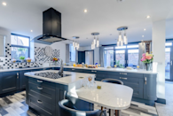 <p>In a dark navy, the spacious kitchen provides a place for guests to unwind after exploring the beautiful Yorkshire countryside. </p>