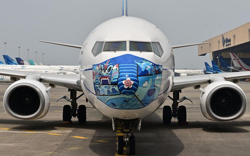 A Garuda Indonesia Boeing 373-800 with a new mask design - ADEK BERRY/AFP