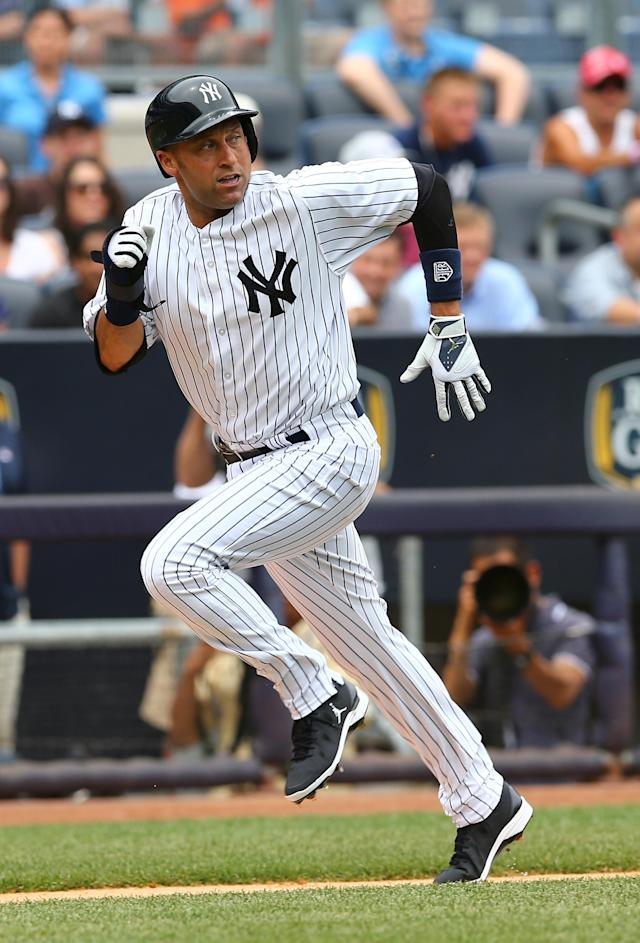 NEW YORK, NY - JULY 11: Derek Jeter #2 of the New York Yankees scores a run in the first inning against the Kansas City Royals on July11,2013 at Yankee Stadium in the Bronx borough of New York City. (Photo by Elsa/Getty Images)