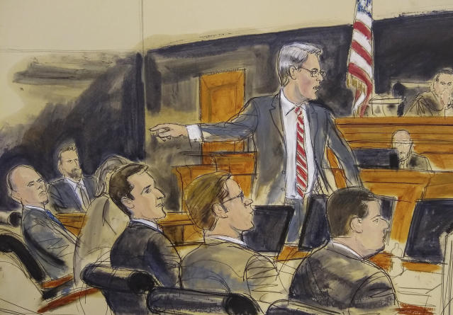 In this courtroom sketch, Assistant U.S. Attorney Robert Sobelman, standing, points to Michael Avenatti, far left, as he makes opening remarks during trial in New York, Wednesday Jan. 29, 2020. A prosecutor kicked off opening statements at Avenatti's attempted extortion trial by saying the deep-in-debt California lawyer tried to extort Nike to line his pockets. (Elizabeth Williams via AP)