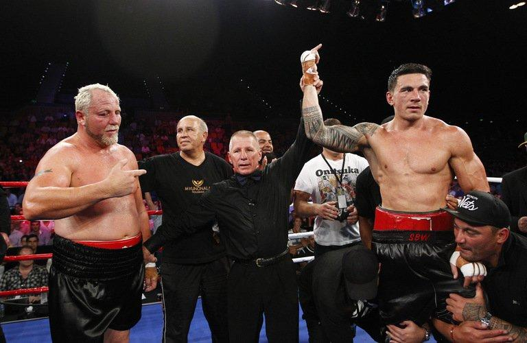 World Cup-winning ex-All Black Sonny Bill Williams (R) celebrates victory over Francois Botha of South Africa after their WBA International Heavyweight Title fight at the Brisbane Entertainment Centre in Australia, on February 8, 2013