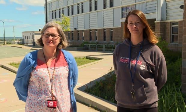 Paradise Elementary principal Debbie Smith, left, and vice-principal Gail Dyke were disappointed that their school's Pride flag was stolen over the weekend.  (Jeremy Eaton/CBC - image credit)