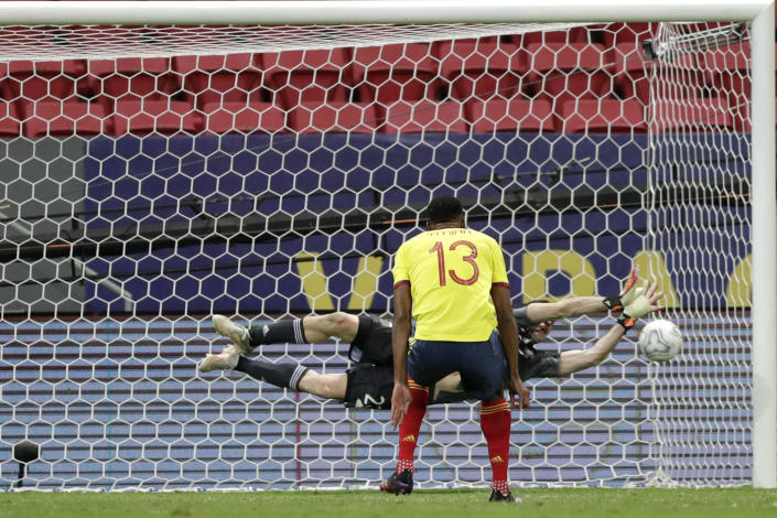 Argentina's goalkeeper Emiliano Martinez blocks a penalty shot by Colombia's Yerry Mina during the penalty shootout in a Copa America semifinal soccer match at the National stadium in Brasilia, Brazil, Wednesday, July 7, 2021. (AP Photo/Eraldo Peres)