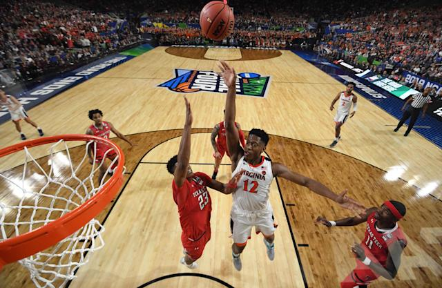De'Andre Hunter #12 of the Virginia Cavaliers shoots the ball over Jarrett Culver #23 of the Texas Tech Red Raiders during the first half of the 2019 NCAA men's Final Four National Championship game at U.S. Bank Stadium on April 08, 2019 in Minneapolis, Minnesota. (Photo by Brett Wilhelm/NCAA Photos via Getty Images)