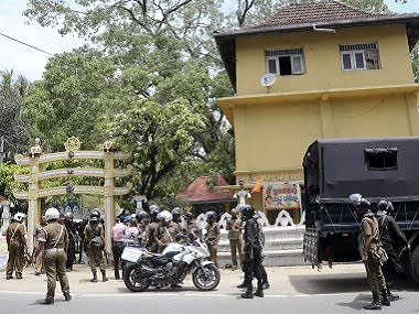 Police stand guard in parts of Sri Lanka on Thursday. AP