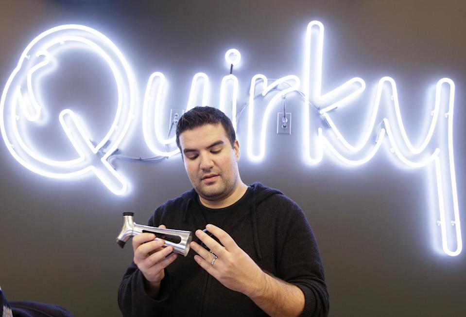 """In this Thursday, Nov. 21, 2013 photo, Quirky CEO Ben Kaufman looks a a wine and bottle opener his company markets, in New York. Kaufman created an employee """"blackout week"""" once each quarter in which no one besides the company's customer service representatives area allowed to work. The startup company shepherds inventions to the marketplace. (AP Photo/Kathy Willens)"""
