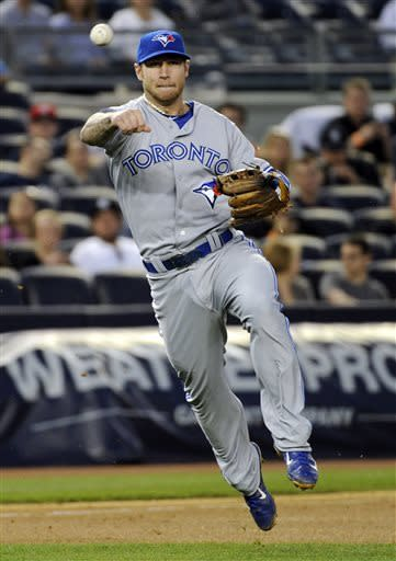 Toronto Blue Jays third baseman Brett Lawrie throws out New York Yankees' Ben Francisco during the fourth inning of a baseball game, Friday, May 17, 2013, at Yankee Stadium in New York. (AP Photo/Bill Kostroun)