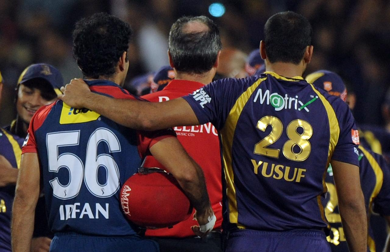 Delhi Daredevils cricketer Irfan Pathan is consoled by brother and Kolkata Knight Riders cricketer Yusuf Pathan after the IPL Twenty20 first playoff cricket match between Delhi Daredevils and Kolkata Knight Riders at  Subrata Roy Sahara Stadium in Pune on May 22, 2012.  RESTRICTED TO EDITORIAL USE. MOBILE USE WITHIN NEWS PACKAGE    AFP PHOTO/Indranil MUKHERJEE        (Photo credit should read INDRANIL MUKHERJEE/AFP/GettyImages)