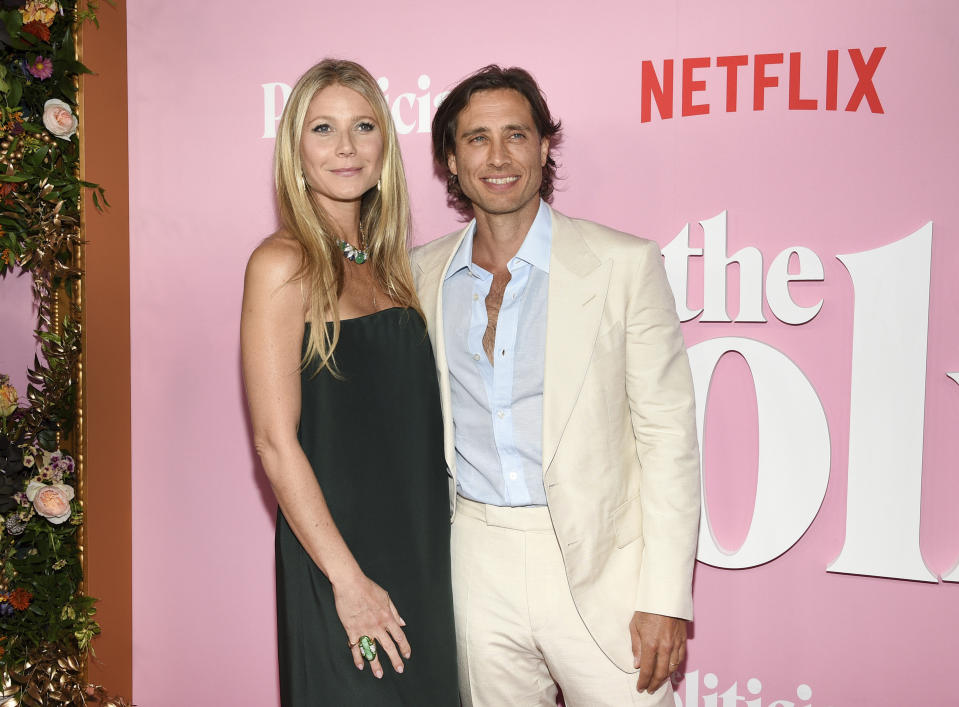 Actress Gwyneth Paltrow, left, and husband Brad Falchuk attends the premiere of Netflix's