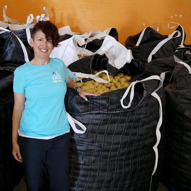 The author at Feeding Palm Beach County. The food bank had just received a massive donation of potatoes to be sorted and packaged by volunteers into family-friendly bags. (Jess Kurti)