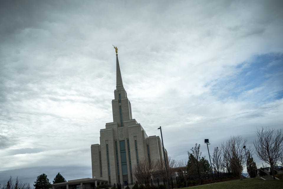 The Moroni statue on top of the Oquirrh Mountain Temple of the Church of Jesus Christ of Latter-day Saints is silhouetted against the sky in South Jordan, Utah, Sunday, Nov. 15, 2020. While the church has traditionally been overwhelmingly conservative and Republican, today there's also an increasingly large strain of liberal members. The church has also begun to directly address its history of racism, including a ban on Black priests that it lifted four decades ago. (AP Photo/Wong Maye-E)