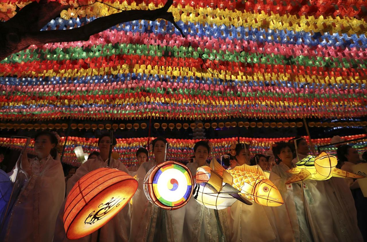 <p>Buddhists hold lanterns after a parade during the Lotus Lantern Festival celebrating the upcoming birthday of Buddha on May 3, at the Jogye Temple in Seoul, South Korea, Saturday, April 29, 2017. (AP Photo/Lee Jin-man) </p>