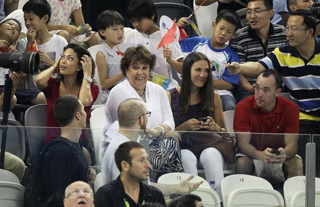 SHANGHAI, CHINA - JULY 28:  Michael Phelps' girlfriend Nicole Johnson (L), mother Debbie (C) and sister Hilary look on during Day Thirteen of the 14th FINA World Championships at the Oriental Sports Center on July 28, 2011 in Shanghai, China.  (Photo by Ezra Shaw/Getty Images)